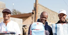 Raymond Phiri (centre), owner of Motion Bags and his team.jpg