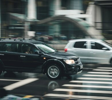 black-suv-beside-grey-auv-crossing-the-pedestrian-line-125514