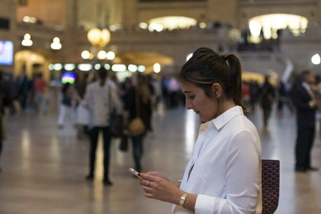 woman-looking-at-her-phone-at-grand-central-station-in-new-york---roy3775-2-5.jpg