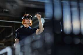 Woman in factory using AR_