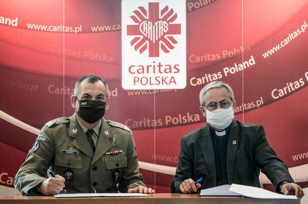 Podpisanie porozumienia pomiędzy WOT i CARITAS