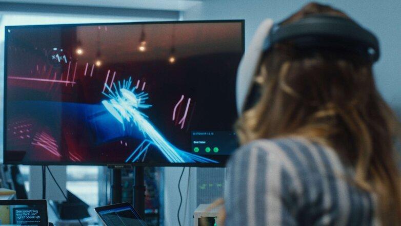 Woman playing virtual reality game web